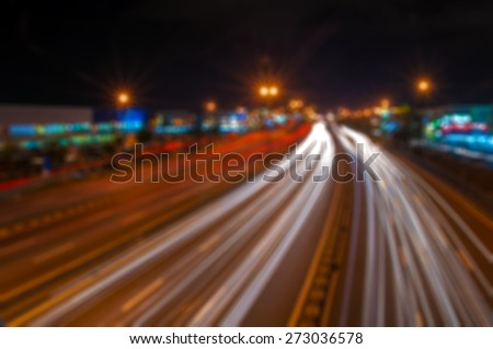 Blur image of a busy street in a city with bokeh - stock photo