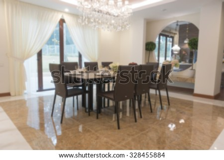 Blur image of a luxury dining room table inside a house