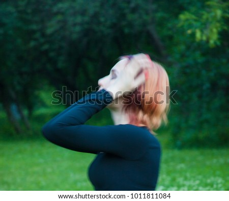 Blur image of a woman in depression standing in the park