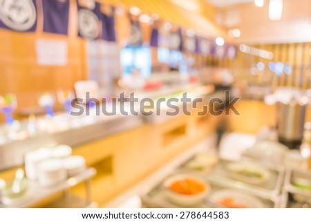 blur image of Abstract blurry sushi counter in vintage style decoration restaurant.