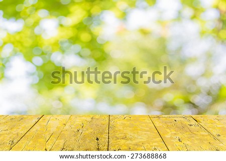 blur image of Abstract Bokeh of tree green color background. - stock photo