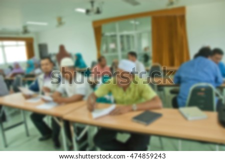 blur image of adult asian muslims in classroom for background