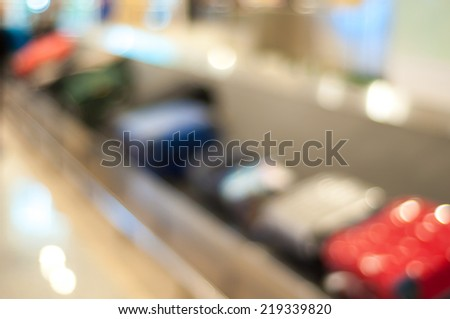 Blur image of baggage belt at Bali airport - stock photo