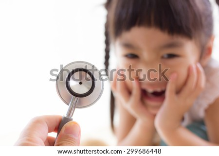 Blur image of children fear stethoscope on white background.