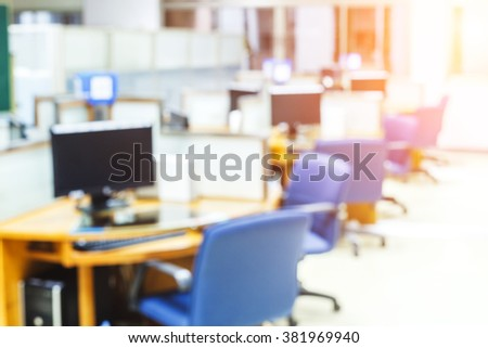 blur image of computer room and light  - stock photo