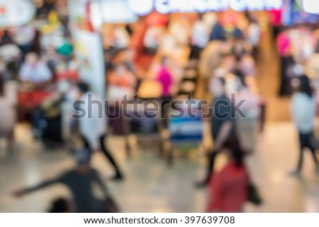 Blur image of  Crowd of anonymous people at airport - stock photo