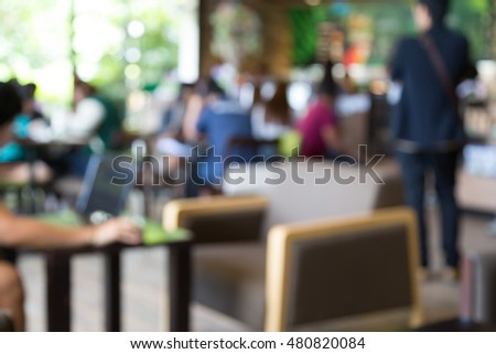 Blur image of customers at coffee cafe or restaurant background