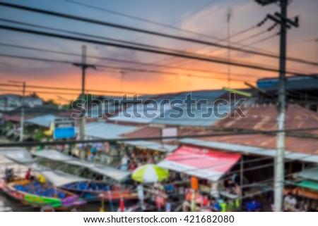 Blur image of floating market background at night in Amphawa, Samut Songkhram, Thailand. - stock photo