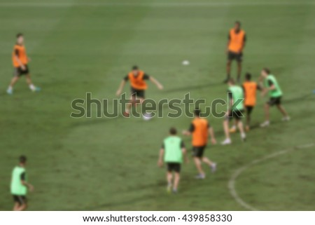 blur image of Football training session - stock photo