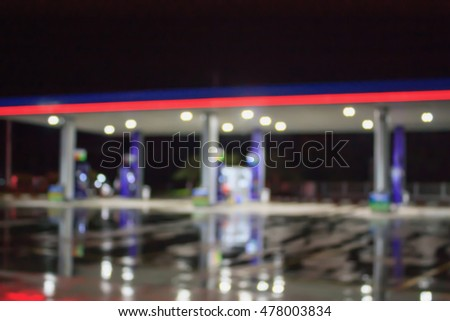 blur image of gas station at night