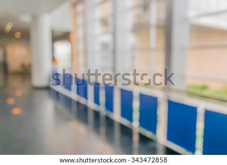 blur image of hospital hallway for medical background. - stock photo