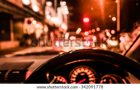 blur image of inside car with bokeh lights with  on night time for background usage. (vintage tone)