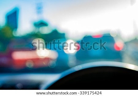 blur image of inside car  with bokeh on day time for background usage . - stock photo