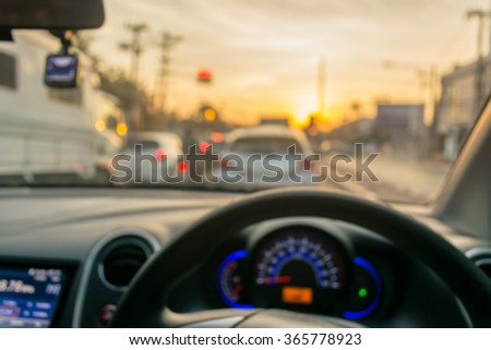 blur image of inside car with bokeh on day time for background usage.