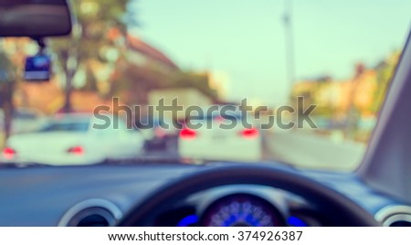 blur image of inside car with bokeh on day time for background usage. (vintage  tone)