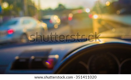 blur image of inside car with bokeh on evening time for background - stock photo
