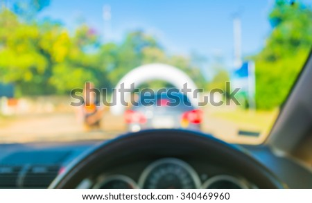 blur image of inside car with bokeh on the rally track  for background usage . - stock photo