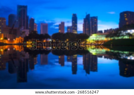 Blur image of Kuala Lumpur city taken at Symphony Lake during blue hour