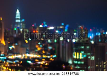 Blur image of Kuala Lumpur city with circle bokeh - stock photo