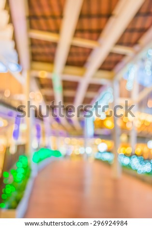 blur image of Long empty corridor on night time with bokeh for background usage.