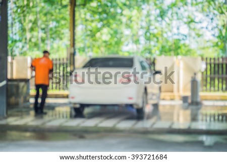 Blur image of man worker polishing car wash.