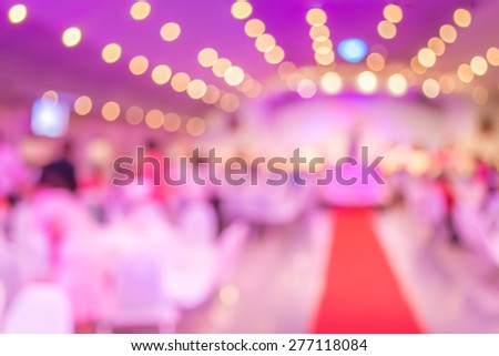 blur image of many people at  wedding ceremony in large hall - stock photo