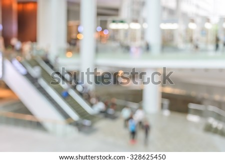 Blur image of modern building lobby with escalator. Business concept - stock photo