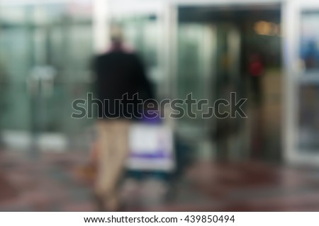 Blur image of passenger walking in airport. the airport blur for background. - stock photo