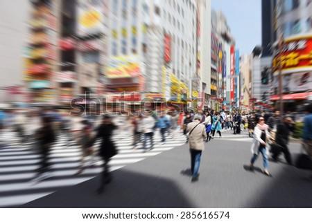 Blur image of Pedestrians walk at Kabuki-cho district, Tokyo, Japan - stock photo
