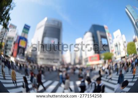 Blur image of Pedestrians walk at Shibuya district in Tokyo - stock photo