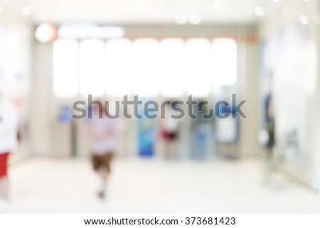 Blur image of people at automatic teller machine (ATM) for background uses