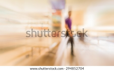 blur image of people in living room for background usage. - stock photo