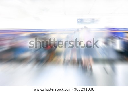 blur image of people on platform of sky train station in Thailand