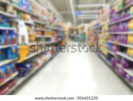 Blur image of pet food in super market - stock photo