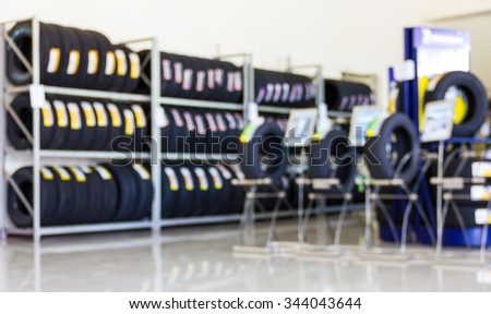 Blur image of shop and tire repair services use for background. - stock photo