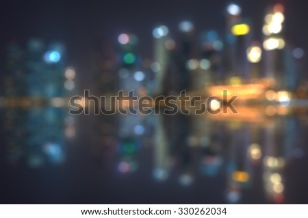 Blur Image of Singapore Cityscapes at Night - stock photo