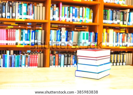 blur image of the library or Book shelf Knowledge and Research in Education