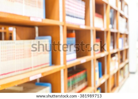 blur image of the library or Book shelf Knowledge and Research in Education  and light