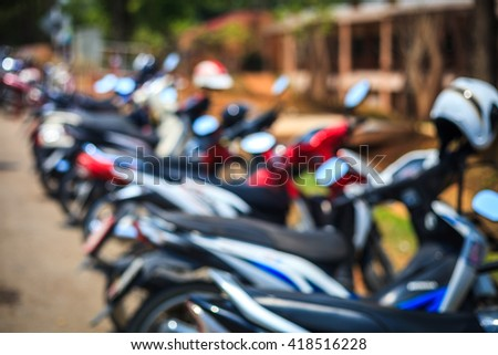 blur image of the parking motorbikes on outdoors - stock photo