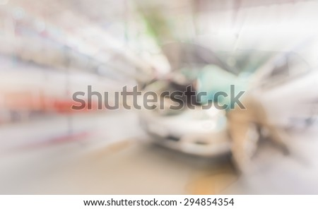 blur image of worker fixing car in ther garage for background usage. - stock photo