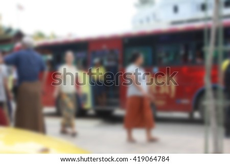 Blur image People, local bus in downtown Yangon, Myanmar.for background usage. - stock photo