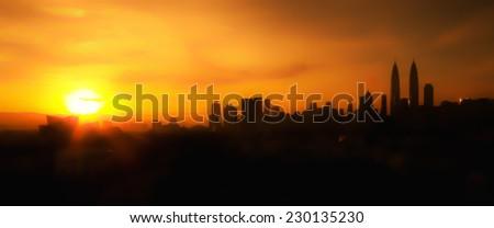 Blur image silhouette of Kuala Lumpur city panorama during sunrise - stock photo
