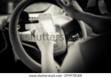 Blur images of people using smartphones while driving, safety driving.
