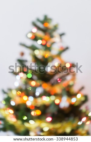 blur light celebration on christmas tree with white background