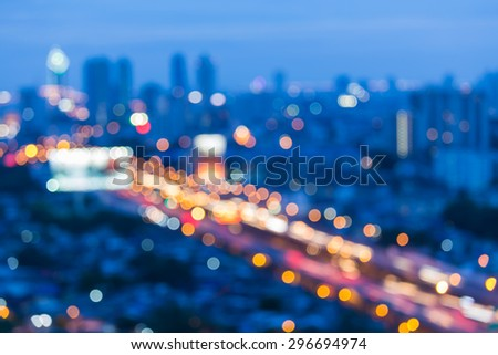 Blur motion of city traffic lights bokeh at busy hours - stock photo