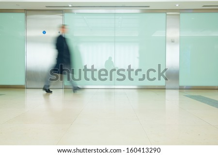 Blur Movement Business man walking in Rush Hour, London, UK - stock photo