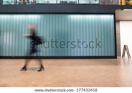 Blur Movement Business people shopping & walking in Rush Hour, London, UK  - stock photo