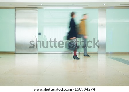 Blur Movement Business people walking in Rush Hour train station, London, UK  - stock photo