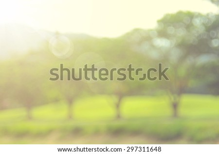 Blur nature park with green tree abstract background.Retro color style. - stock photo