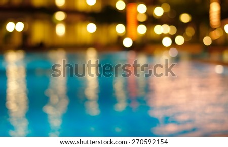 blur night light reflection in blue water - stock photo